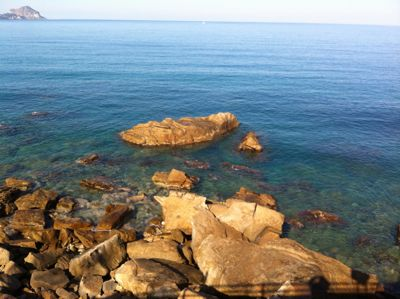 the deep blue waters of the sea on a rocky stretch of coastline